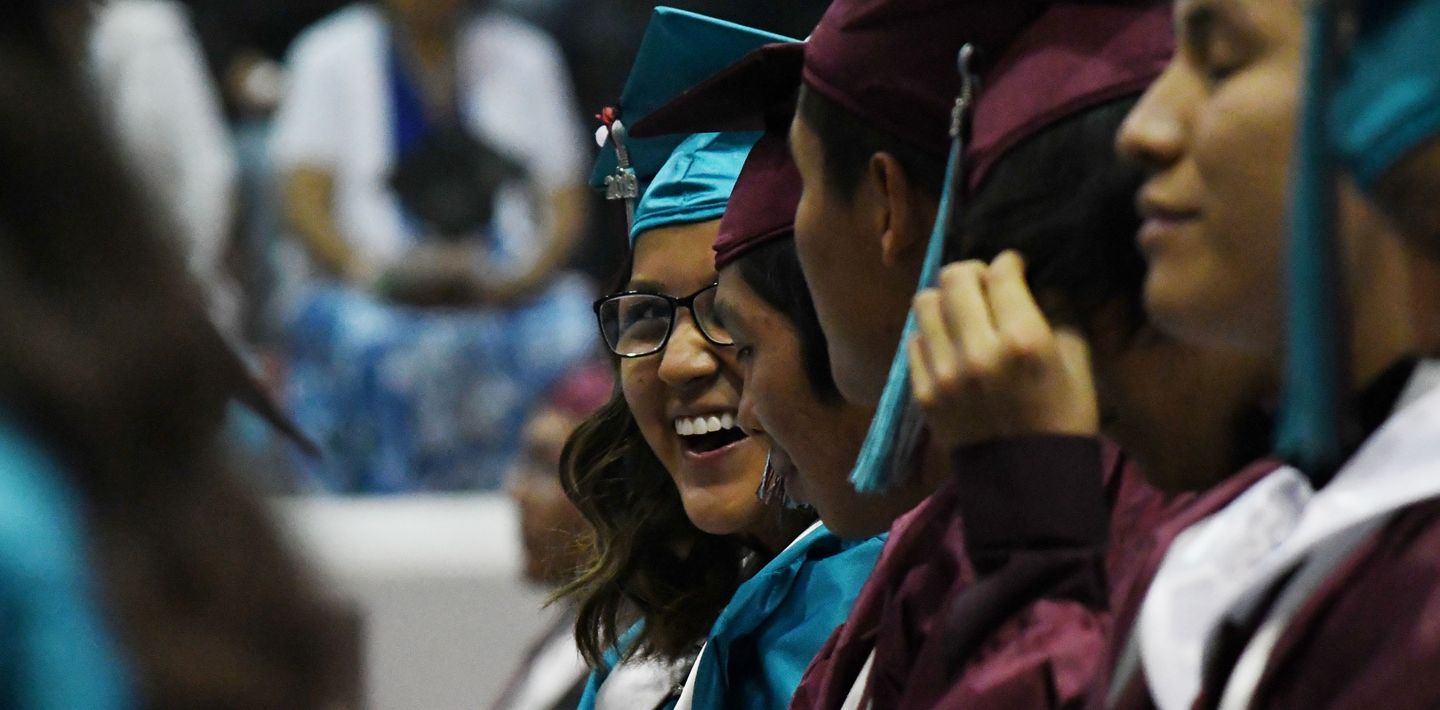 A student smiles during Graduation at Shiprock High School