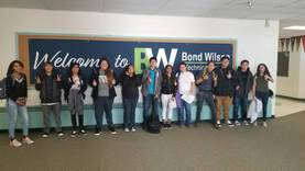 Students in front of a sign reading 'Welcome to BW Bond Wilson Technical Center'