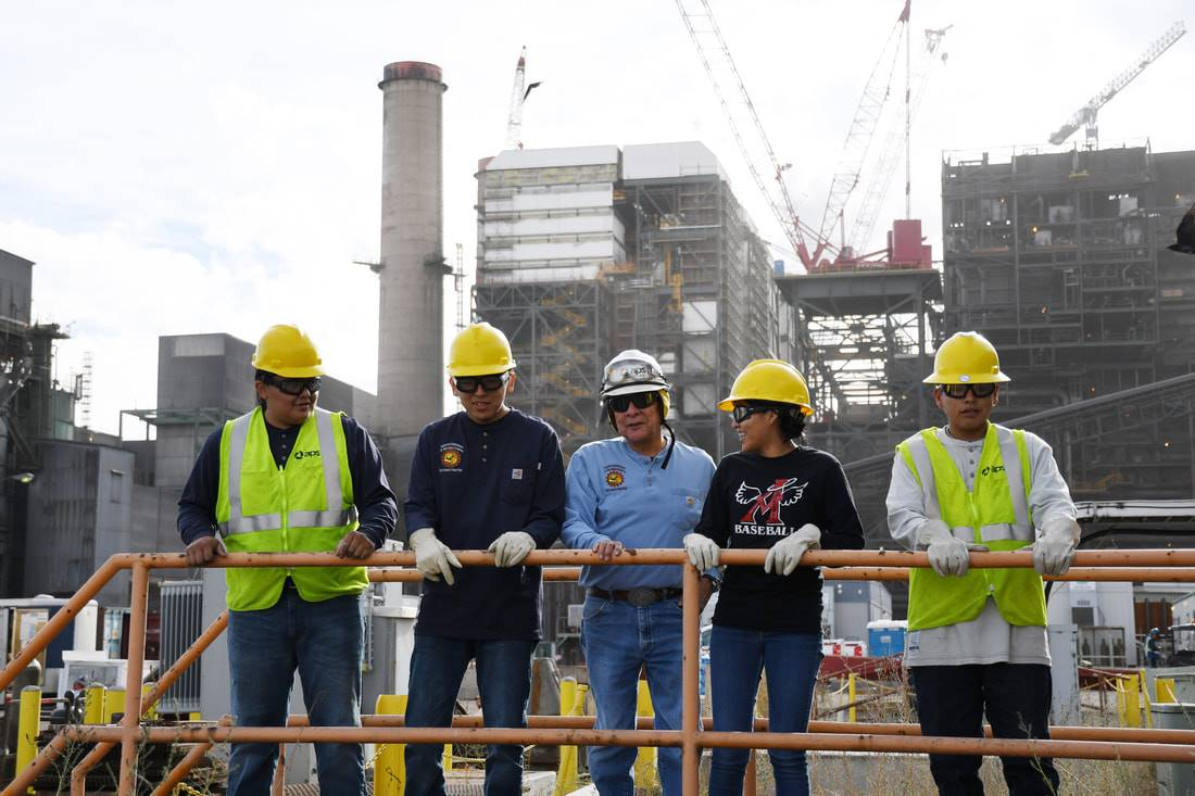 Students and adults in a construction site