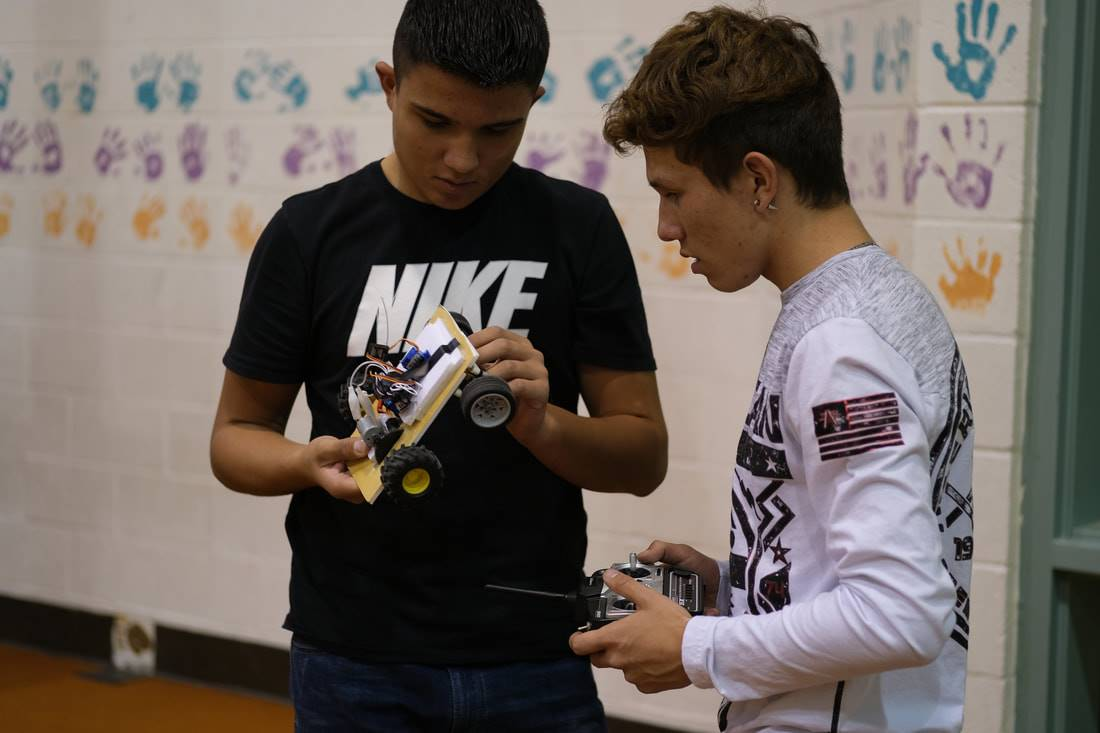 Students with an RC car